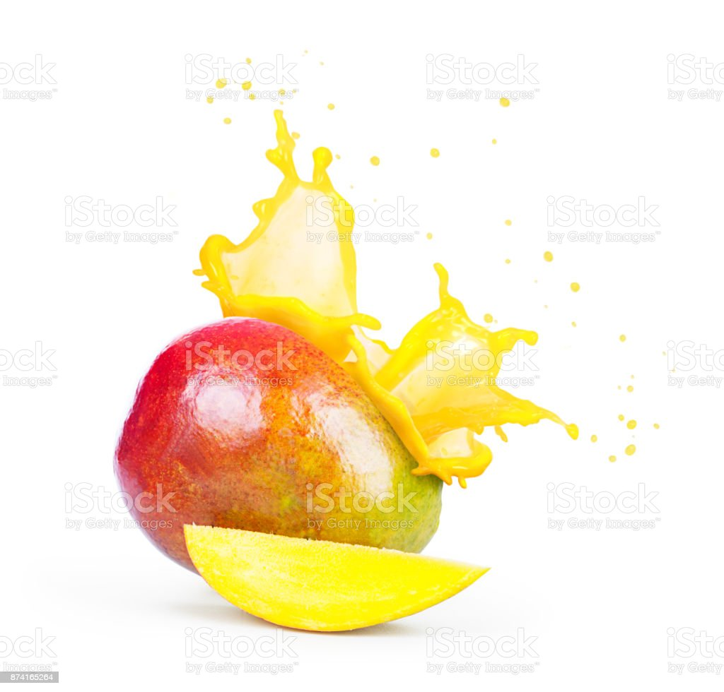 Mango with a splash of mango juice stock photo