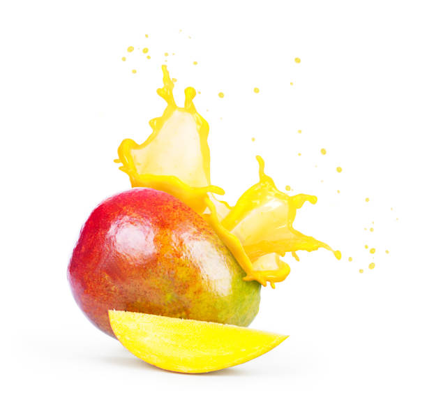 mango with a splash of mango juice - juicy stock photos and pictures