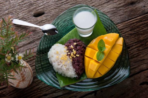 Mango with sticky rice in Thai style dessert. stock photo