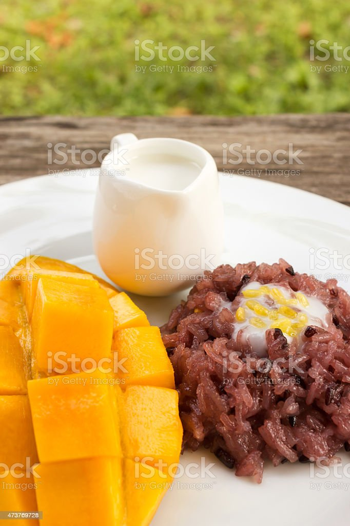Mango with sticky rice, traditional dessert of thailand. stock photo
