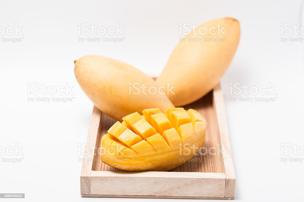 mango with wooden tray on white background royalty-free stock photo