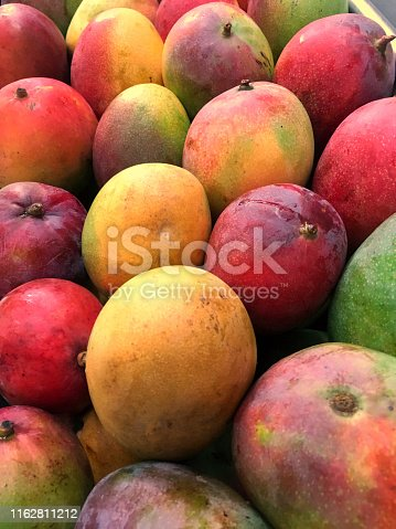 Large heap of mangoes in a fruit store.