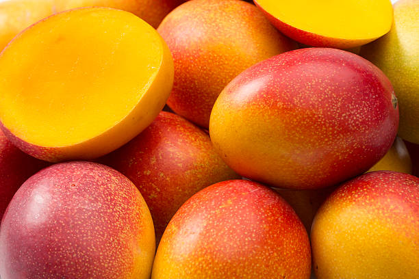 Mangoes Mangoes composition (fullframe) mango stock pictures, royalty-free photos & images