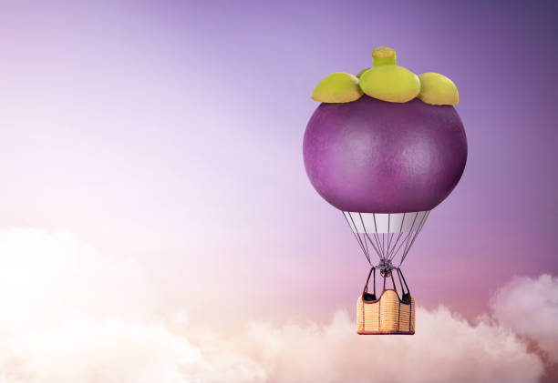 3d mangosteen hot air  balloon floating in the sky; air travel and aircraft,tourism and recreation. sky objects. - hot air balloon стоковые фото и изображения