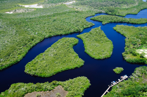 A small river with mangroves and dock for boating. Taken by helicopter at 500 feet.