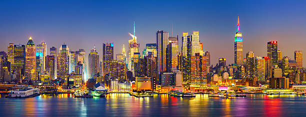 manhattan after sunset - skyline stock photos and pictures