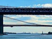A view of Manhattan bridge, Brooklyn bridge and Statue of Liberty.