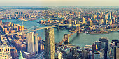 Panoramic view of Manhattan and Brooklyn Bridges. Cityscape of New York.