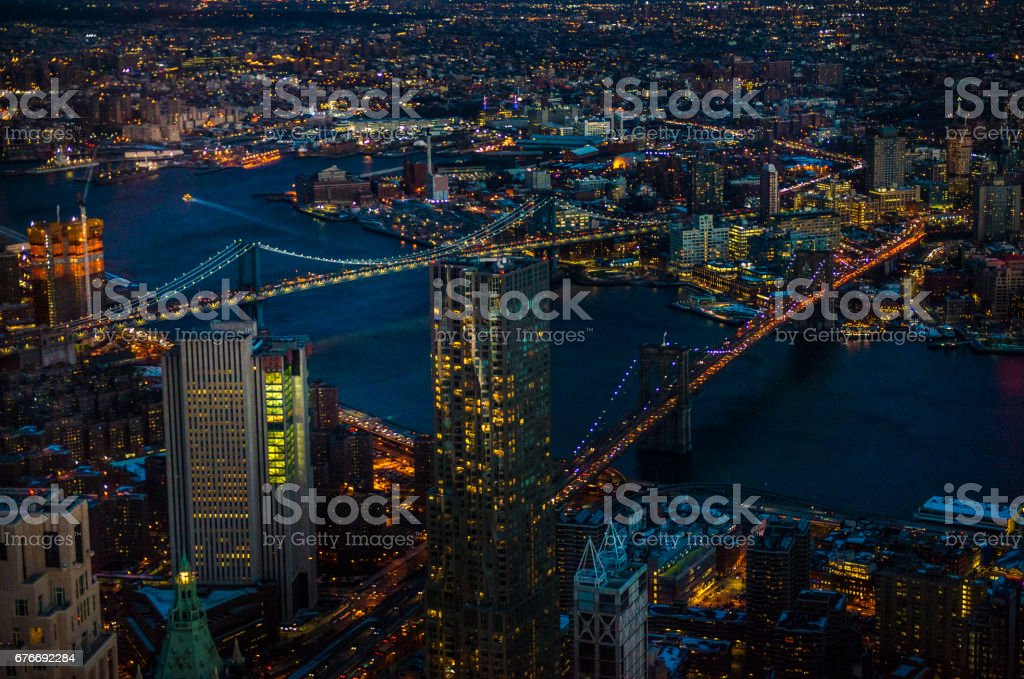 Manhattan and Brooklyn bridges via One World Trade Center observation point at night stock photo