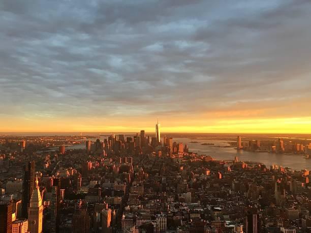 Manhattan and New York at sunset. stock photo