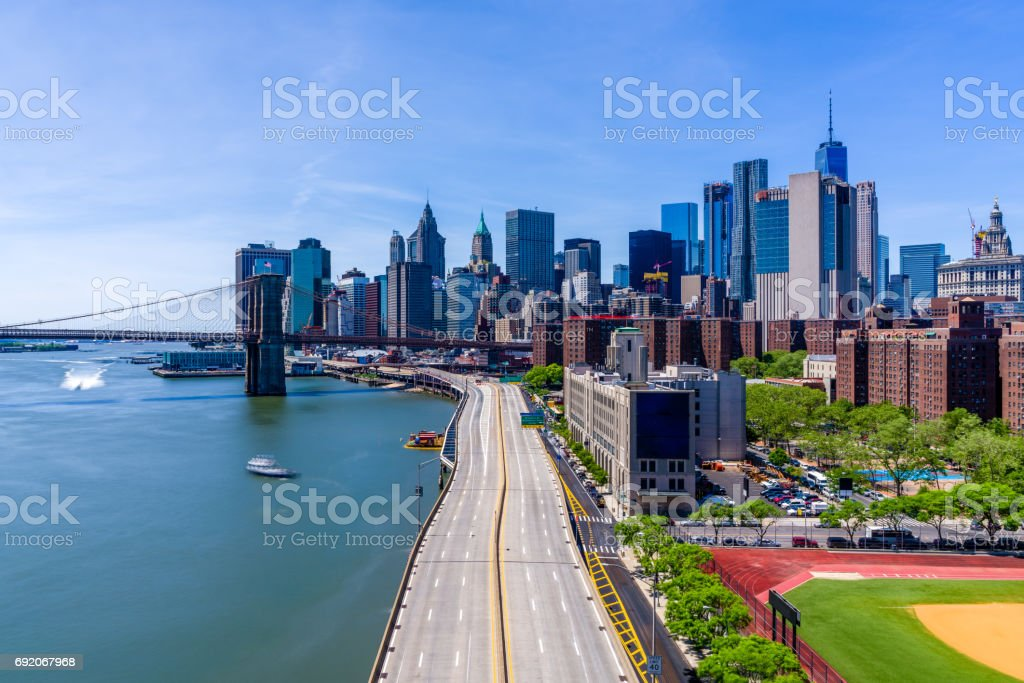 Manhattan and the Brooklyn Bridge in a sunny day stock photo