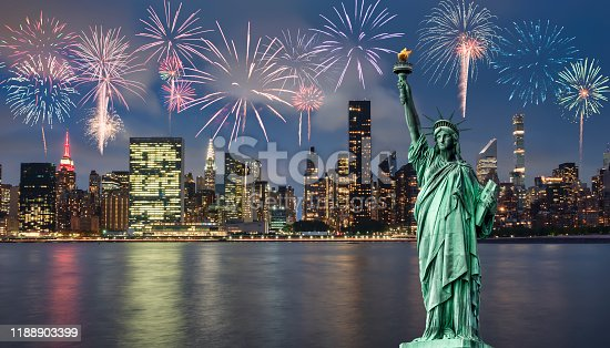 952065128 istock photo Manhattan at night and statue of liberty with fireworks 1188903399
