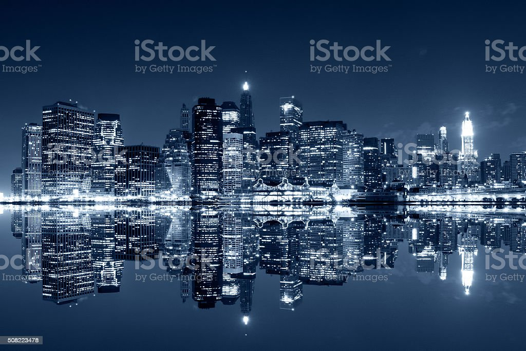 Manhattan at night with reflections on Harlem river stock photo