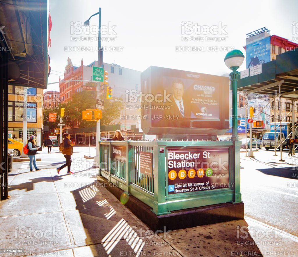 Manhattan Bleecker Street Subway entrance with surrounding intersection royalty-free stock photo