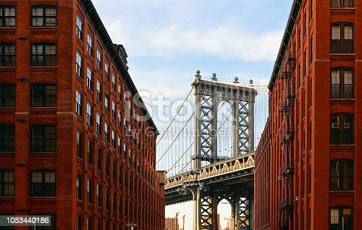 Manhattan Bridge and brick wall old  buildings and architectures in Brooklyn in DUMBO district, New York City, USA