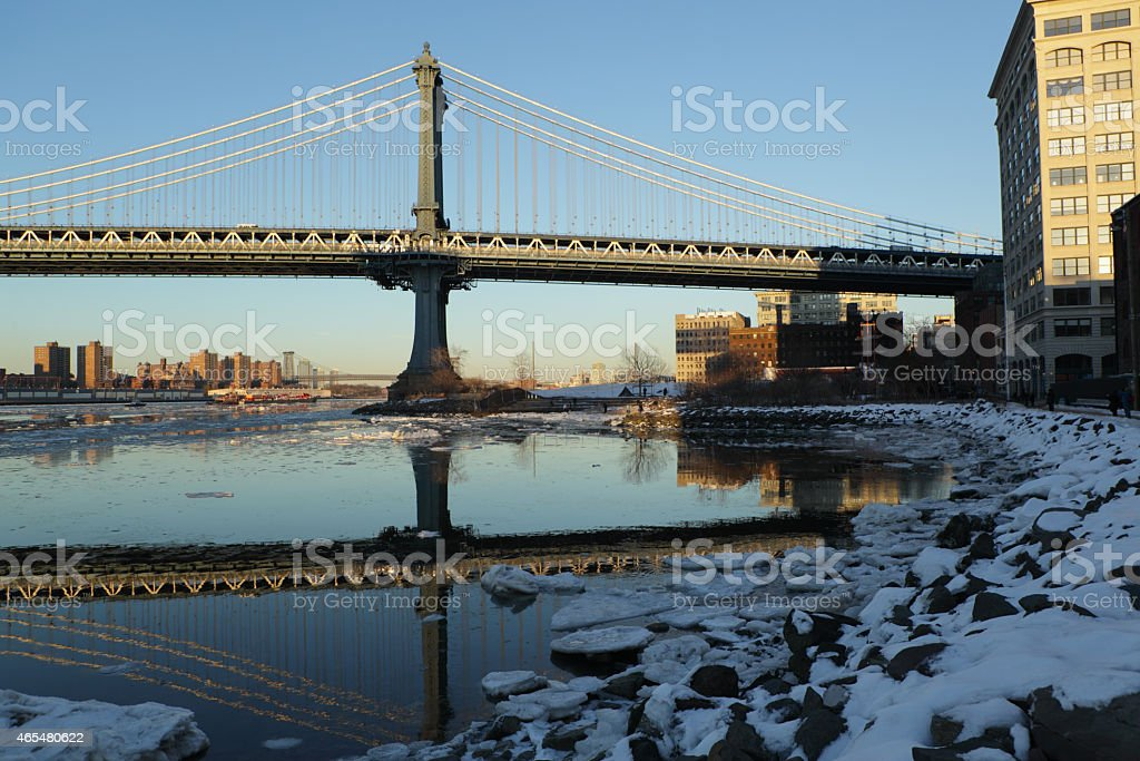 Manhattan Bridge and ice in the East River in winter stock photo