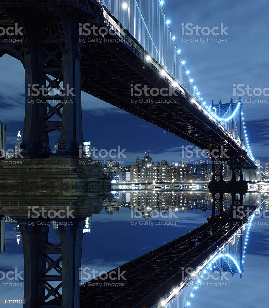 Manhattan Bridge and New York City Skyline At Night royalty-free stock photo
