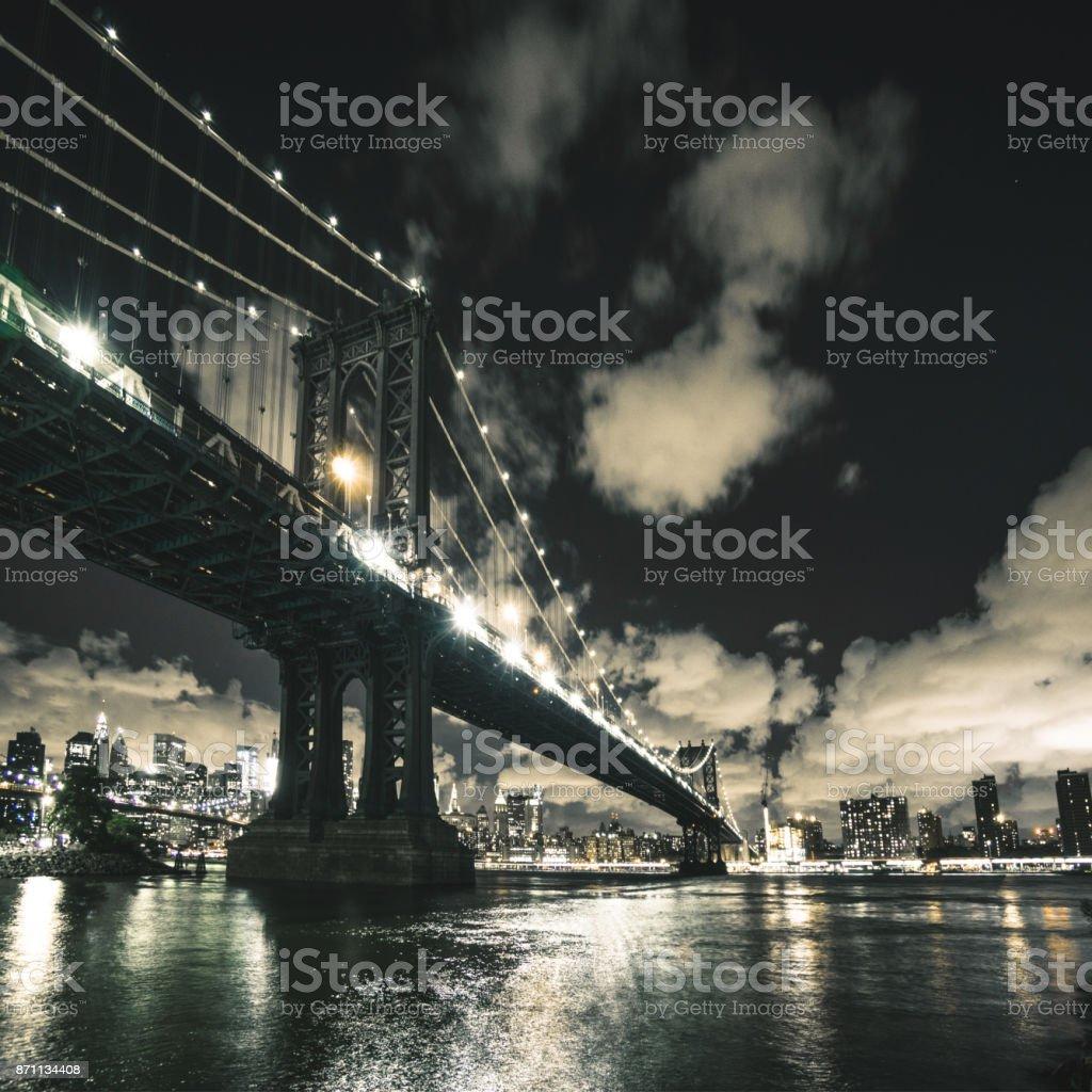 manhattan bridge at night in nyc stock photo