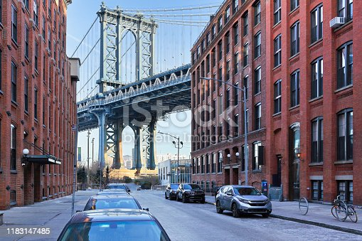 Manhattan bridge as seen from Dumbo (Down Under the Manhattan Bridge Overpass) neighborhood of Brooklyn. The Manhattan Bridge - a 6,855ft suspension bridge crossing the East river - connects Lower Manhattan and downtown Brooklyn. Designed by Leon Moisseiff and known for its innovative design, the bridge opened to traffic in 1909.