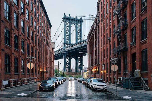 manhattan bridge in new york - lower east side manhattan stock pictures, royalty-free photos & images