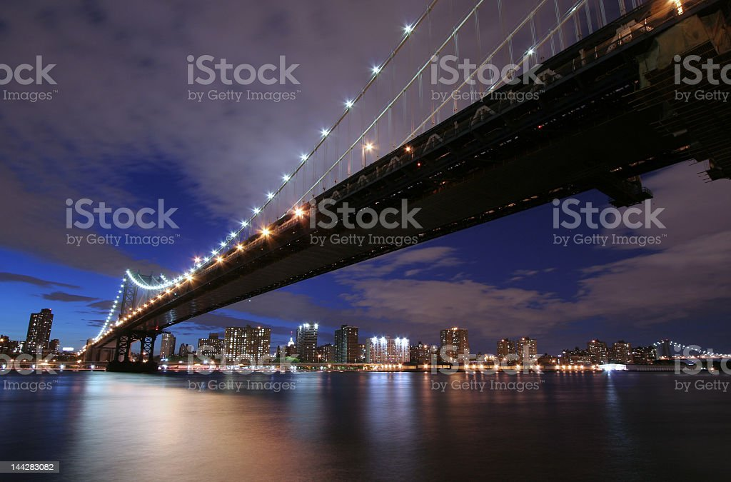 Manhattan Bridge under a dramatic sky royalty-free stock photo