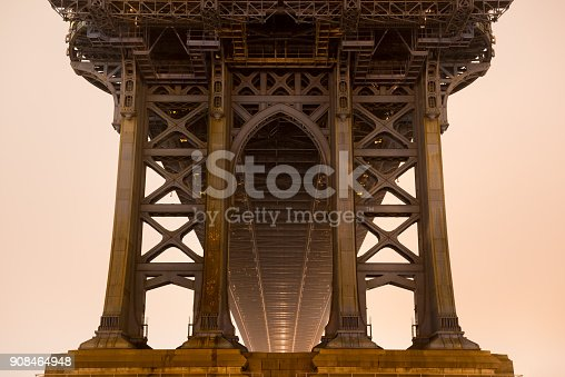 The underside of the Manhattan Bridge on a foggy night.