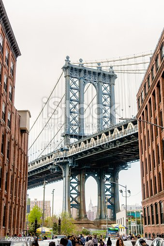 NEW YORK, USA - APRIL 28, 2018: Manhattan Bridge view from Dumbo, Yew York City. New York City is the most populous city in the United States of America.