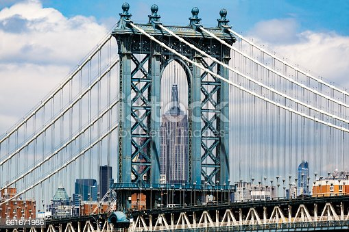 Empire State Building framed within the archway of Manhattan Brigde