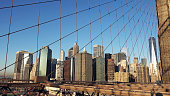 The Famous Brooklyn Bridge at Sunrise, New York City, USA. The sun is rising over Brooklyn on this beautiful day