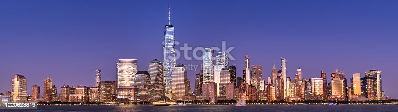 Buildings and skyscrapers of the Manhattan urban skyline over the Hudson river in New York USA