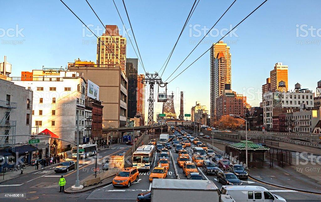 Manhattan City Street and Queensboro Bridge stock photo