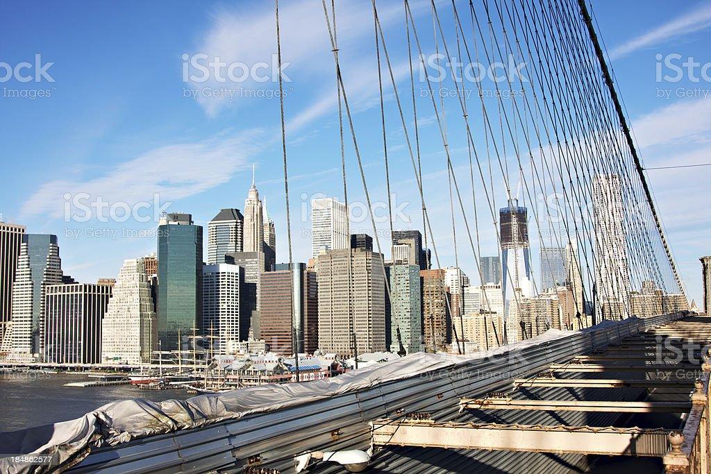 Manhattan cityscape seen from Brooklyn bridge stock photo