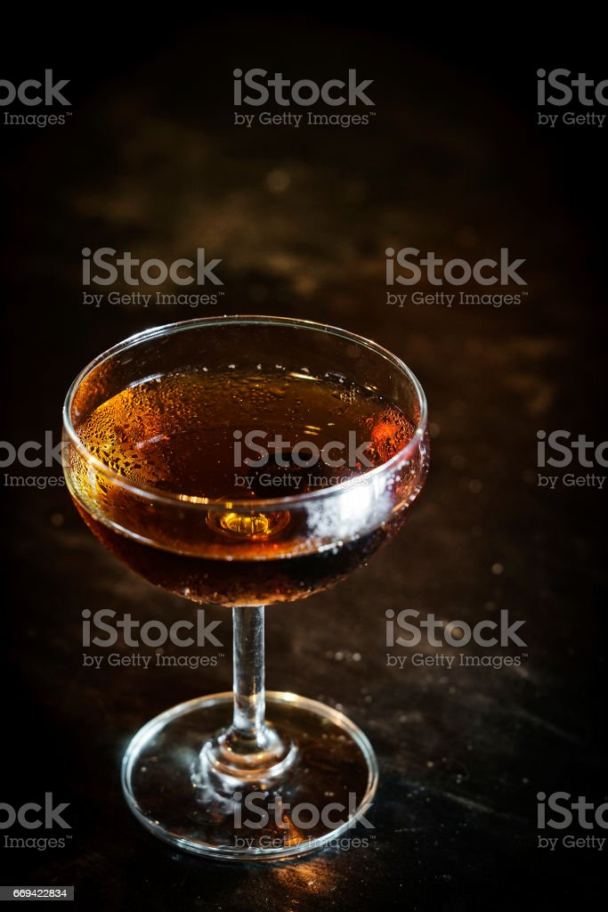 manhattan classic whisky cocktail drink in modern bar stock photo