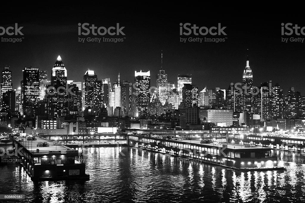 Manhattan coast at night black and white stock photo