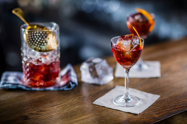 Manhattan cocktail drink decorated on bar counter in pub or restaurant stock photo