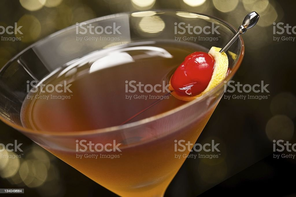 Manhattan cocktail garnished with a cherry and lemon stock photo