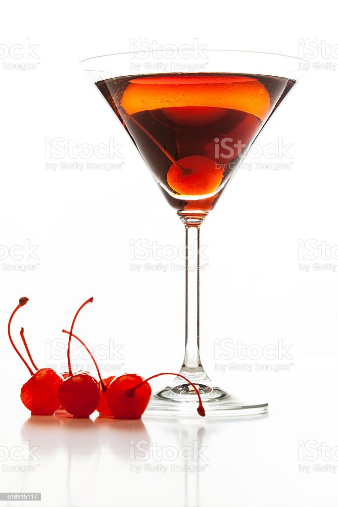 Manhattan cocktail garnished with a cherry stock photo