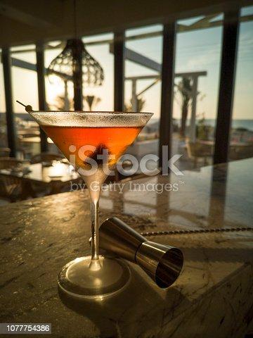 istock Manhattan cocktail on bar counter at sunset 1077754386