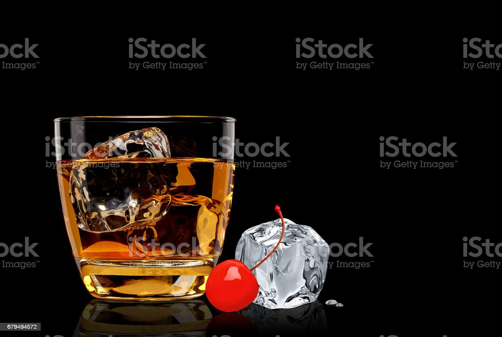 Manhattan cocktail with ice cube stock photo