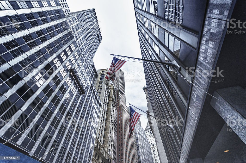 Manhattan financial district with us flag royalty-free stock photo