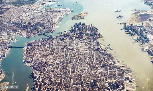 An aerial view of Manhattan Island and across to Brooklyn, with the skyscrapers of Lower Manhattan in the centre of the image.