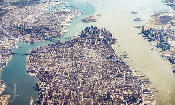 Manhattan Island and Brooklyn from the air An aerial view of Manhattan Island and across to Brooklyn, with the skyscrapers of Lower Manhattan in the centre of the image. hudson river stock pictures, royalty-free photos & images