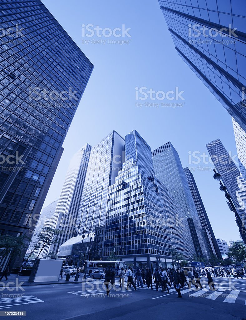 manhattan morning people crossing with skyscrapers in background royalty-free stock photo