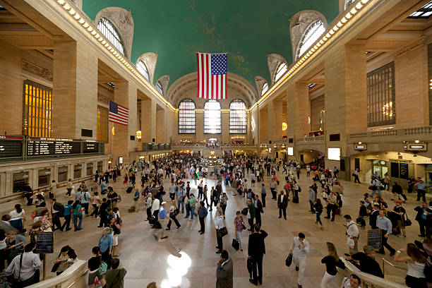 manhattan new york city waiting commuters at grand central station stock photo
