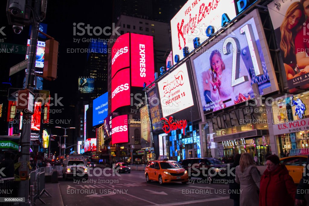 Manhattan, New York, December 20, 2017: Broadway street in Times Square and tourists at night stock photo