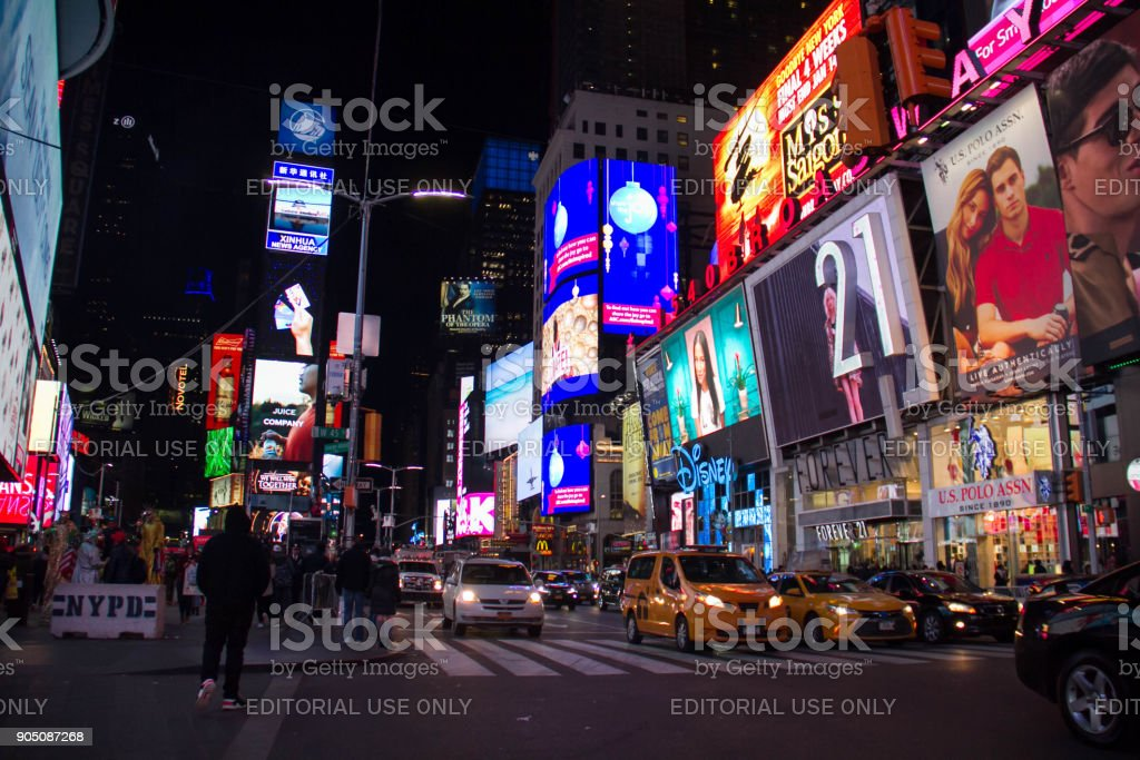 Manhattan, New York, December 20, 2017: Times Square and cars on street at night stock photo