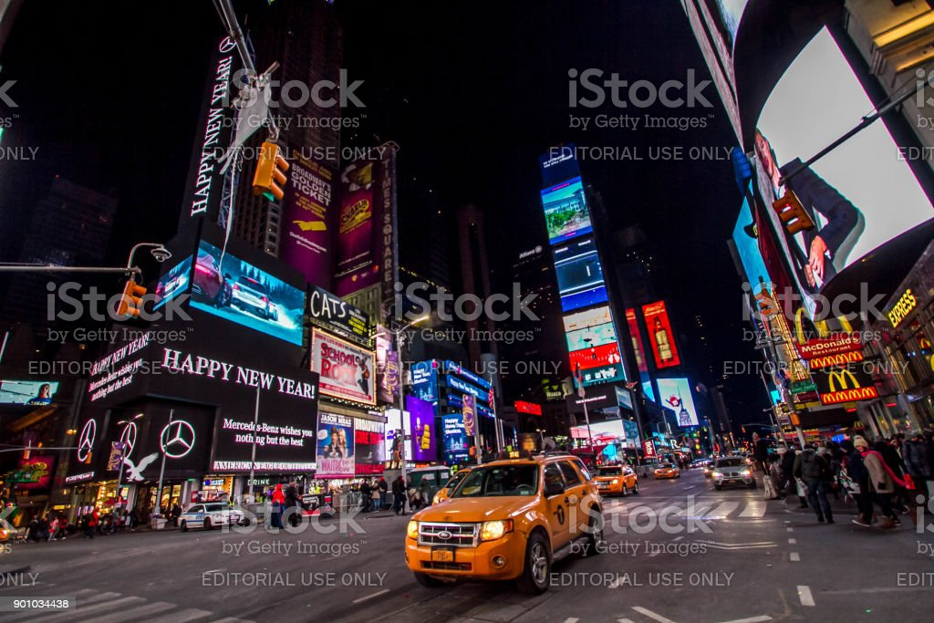 Manhattan: New York, January 1, 2018: taxies on street and billboards on buildings at Times Square on new year day in nighttime stock photo