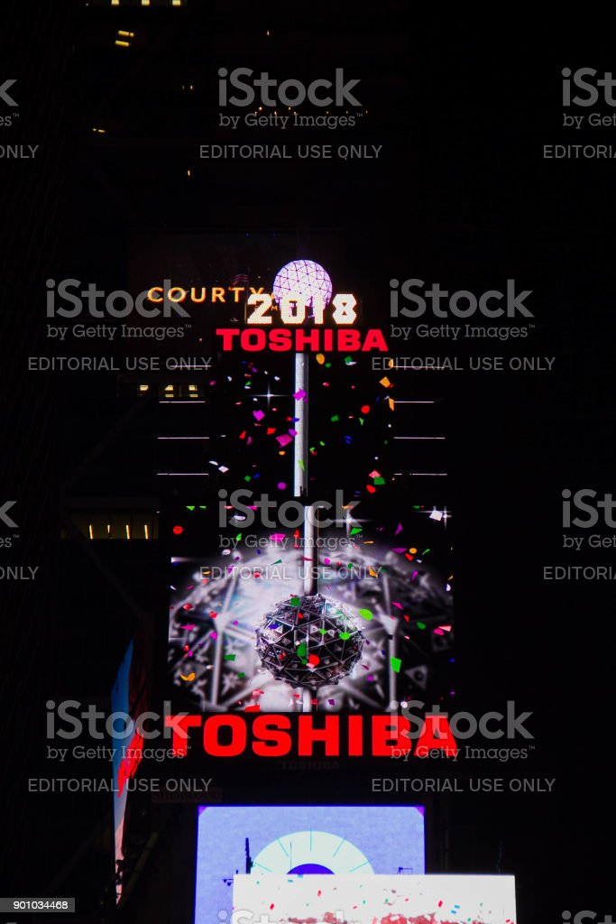 Manhattan: New York, January 1, 2018: the ball drop billboards on buildings at Times Square in nighttime stock photo
