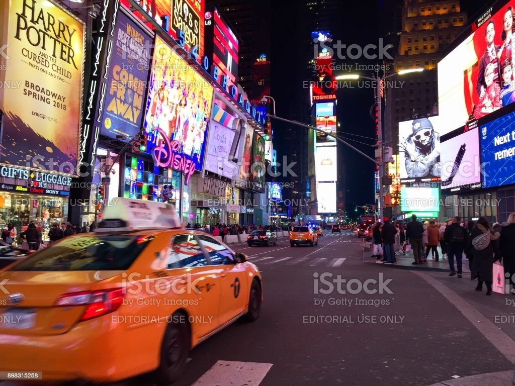 Manhattan, New York, November 23, 2017: Blurred taxi at Times Square stock photo