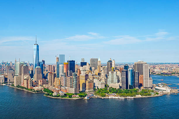 Manhattan, New York Shot from a helicopter, a view of beautiful Manhattan, New York on a clear blue sky summer day. New York City is a large American City in the State of New York. manhattan financial district stock pictures, royalty-free photos & images
